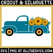 side view of vintage truck with 3 sunflowers in bed of truck